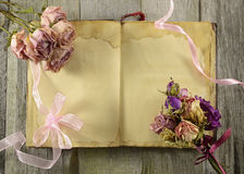 Open diary with flowers Royalty Free Stock Photo