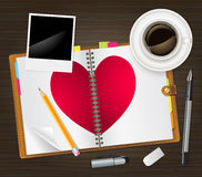 Open diary with a heart Stock Photography