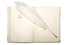 Open diary with japan paper lipstick kiss and feather pen isolat Stock Photography