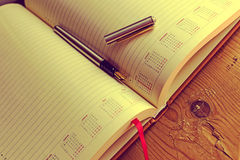 Open diary with one fountain pen in it 1 Royalty Free Stock Photo