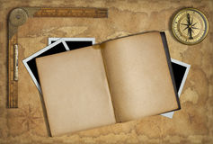 Open diary over old treasure map and compass stock photography