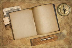 Open diary over old treasure map Royalty Free Stock Photo