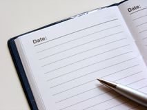 Open diary with pen Royalty Free Stock Images