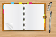 Open diary and a pen Stock Image