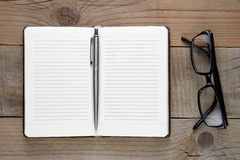 Open diary with pen and glasses Royalty Free Stock Images