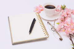 Open diary with a pencil and glasses. Royalty Free Stock Photo