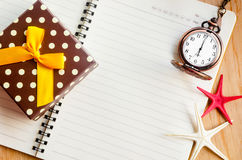 Open diary and pocket watch with gift box. Royalty Free Stock Photography