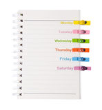 Open diary ring binder and many color wood clamps Stock Photos