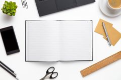 Open Diary Surrounded With Office Supplies On White Desk Stock Images