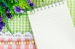 Open diary and violet flower. Stock Photography