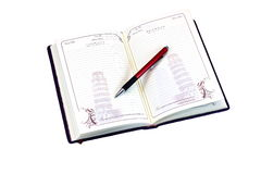 Open diary. On a white background is an open diary, which bears the pen to write it Royalty Free Stock Image