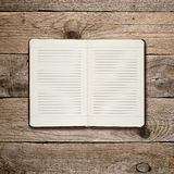 Open diary on wood Royalty Free Stock Photo