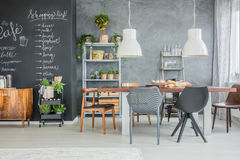 Family table and chalkboard accents. Open dining room with big family table and chalkboard accents Stock Image