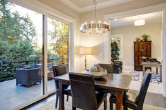 Open dining space design with soft beige walls Stock Photos