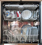 Open dishwasher. With dirty tableware royalty free stock photo