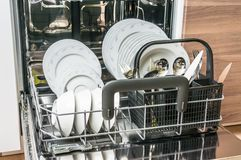 Open dishwasher with clean dishes after cleaning process. Selective focus Stock Photos