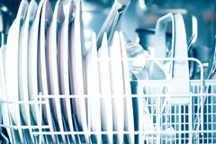 Open dishwasher. Clean dishes in dishwasher close up Royalty Free Stock Photo