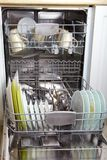 Dishwasher after cleaning process. Open dishwasher with clean glass and dishes Stock Images