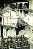 Open dishwasher with clean utensils Royalty Free Stock Photo