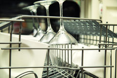 Open dishwasher with clean utensils Stock Photo
