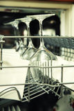 Open dishwasher with clean utensils Stock Images