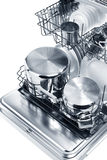 Open dishwasher with clean utensils Royalty Free Stock Images