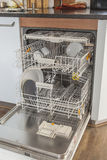 Open dishwasher in kitchen Royalty Free Stock Image