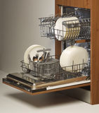 Open dishwasher loaded with cutlery and plates. Open dishwasher loaded with cutlery, plates, cups, shot in profile royalty free stock photography