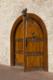 Open door. The open wooden decorated door in a stone wall Royalty Free Stock Photos