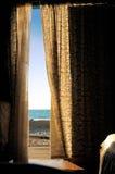 Open door. View of the beach through the open door stock images