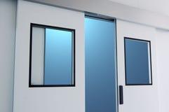 Open door. An opening door against blue light outside royalty free stock image