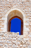 Open wooden door in ancient stone wall. Background Royalty Free Stock Images