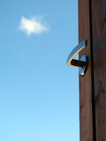 Open door. Against blue sky; opportunities, new beginning, launch, success, freedom concepts Stock Photography