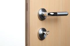 Open door. An open door with key and door knob stock photos