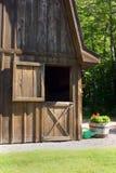 Open Door. A barn open door sybolizes the half open half closed idea Stock Photo