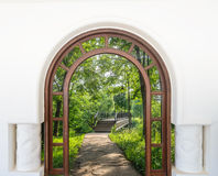 Open door arch with access  alley Stock Photo