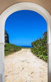 Open door arch with access alley. Open door arch with access to the alley Royalty Free Stock Photography