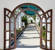 Open door arch  access to the alley Royalty Free Stock Photo