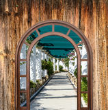 Open door arch with access to  alley Royalty Free Stock Photography