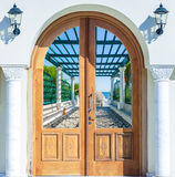 Open door arch with access to  alley Stock Image