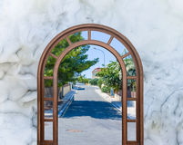 Open door arch with  the alley. Open door arch with access to the alley Stock Photos