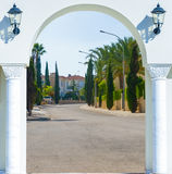 Open door arch with  alley. Open door arch with access to the alley Royalty Free Stock Photo