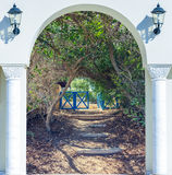 Open door arch with  alley. Open door arch with access to the alley Royalty Free Stock Image