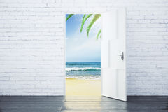 Open door in a beach with ocean waves and palm trees Royalty Free Stock Photography