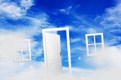 Open door on blue sunny sky. New life, success, hope. Stock Photo