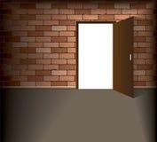 Open door in brick wall Stock Photo