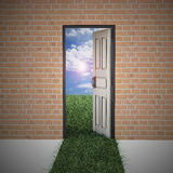 Open door from brick wall to new life . Hope, success, new life and world concepts Royalty Free Stock Photography