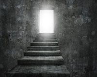 Open door with bright light and old dirty concrete stairs Stock Photo