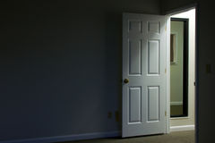 Open door in dark room Stock Photo