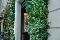 Open door with decorated Christmas tree Stock Photo